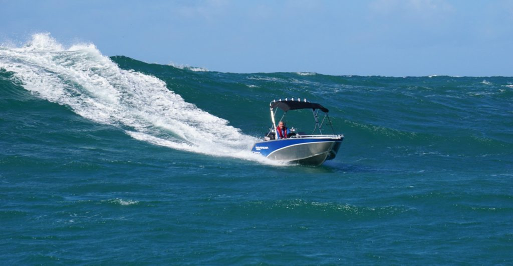 Waverider boat on big wave