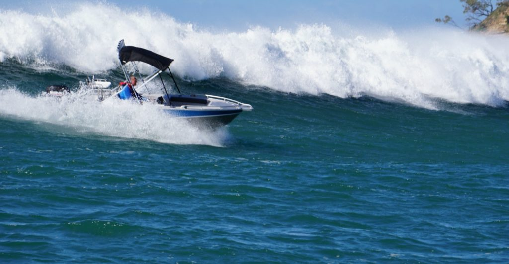 Waverider boat on face of crashing wave