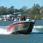 Waverider 550 Centre Console, flying along doing zig-zags in the river.