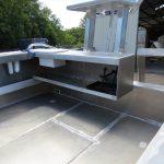 Step-through transom and rear battery/storage shelf.